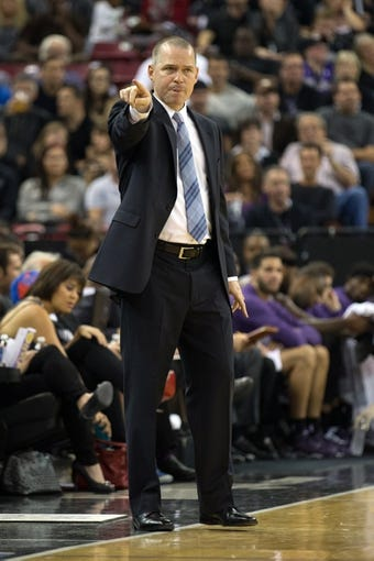 Nov 1, 2013; Sacramento, CA, USA; Sacramento Kings head coach Michael Malone calls out to his players against the Los Angeles Clippers during the third quarter at Sleep Train Arena. The Los Angeles Clippers defeated the Sacramento Kings 110-101. Mandatory Credit: Kelley L Cox-USA TODAY Sports