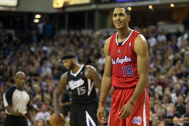 Nov 1, 2013; Sacramento, CA, USA; Los Angeles Clippers center Ryan Hollins (15) reacts after being called for a foul against Sacramento Kings center DeMarcus Cousins (15) during the third quarter at Sleep Train Arena. The Los Angeles Clippers defeated the Sacramento Kings 110-101. Mandatory Credit: Kelley L Cox-USA TODAY Sports