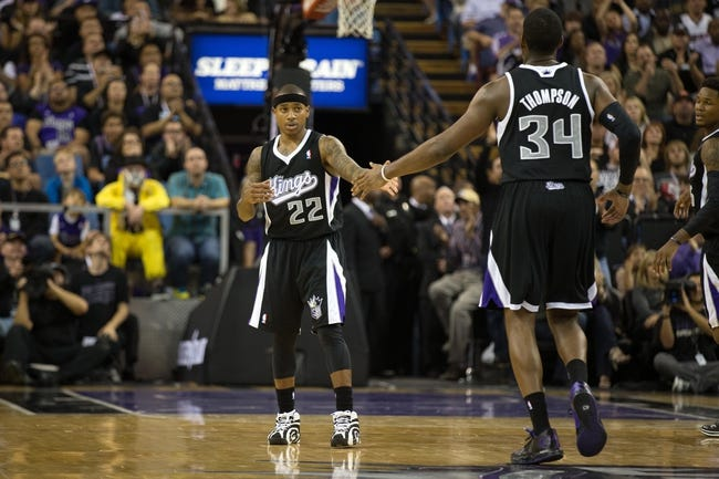 Nov 1, 2013; Sacramento, CA, USA; Sacramento Kings point guard Isaiah Thomas (22) high fives power forward Jason Thompson (34) after a basket against the Los Angeles Clippers during the fourth quarter at Sleep Train Arena. The Los Angeles Clippers defeated the Sacramento Kings 110-101. Mandatory Credit: Kelley L Cox-USA TODAY Sports