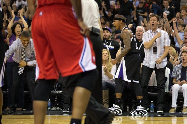 Nov 1, 2013; Sacramento, CA, USA; Sacramento mayor Kevin Johnson and wife Michelle Rhee (far left) and Sacramento Kings minority owner Mark Mastrov (right) stand up in celebration after a basket by point guard Isaiah Thomas (22) against the Los Angeles Clippers during the fourth quarter at Sleep Train Arena. The Los Angeles Clippers defeated the Sacramento Kings 110-101. Mandatory Credit: Kelley L Cox-USA TODAY Sports