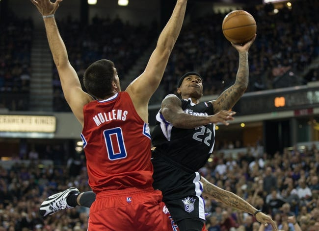 Nov 1, 2013; Sacramento, CA, USA; Sacramento Kings point guard Isaiah Thomas (22) shoots the ball around Los Angeles Clippers center Byron Mullens (0) during the fourth quarter at Sleep Train Arena. The Los Angeles Clippers defeated the Sacramento Kings 110-101. Mandatory Credit: Kelley L Cox-USA TODAY Sports