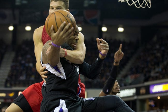 Nov 1, 2013; Sacramento, CA, USA; Los Angeles Clippers power forward Blake Griffin (32) wraps up Sacramento Kings shooting guard Marcus Thornton (23) after a shot clock violation during the fourth quarter at Sleep Train Arena. The Los Angeles Clippers defeated the Sacramento Kings 110-101. Mandatory Credit: Kelley L Cox-USA TODAY Sports