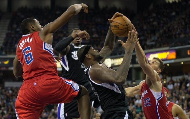 Nov 1, 2013; Sacramento, CA, USA; Sacramento Kings center DeMarcus Cousins (15) gathers a rebound with power forward Jason Thompson (34) between Los Angeles Clippers center DeAndre Jordan (6) and power forward Blake Griffin (32) during the fourth quarter at Sleep Train Arena. The Los Angeles Clippers defeated the Sacramento Kings 110-101. Mandatory Credit: Kelley L Cox-USA TODAY Sports