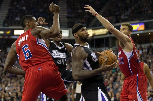 Nov 1, 2013; Sacramento, CA, USA; Sacramento Kings center DeMarcus Cousins (15) looks to the basket between Los Angeles Clippers center DeAndre Jordan (6) and power forward Blake Griffin (32) during the fourth quarter at Sleep Train Arena. The Los Angeles Clippers defeated the Sacramento Kings 110-101. Mandatory Credit: Kelley L Cox-USA TODAY Sports