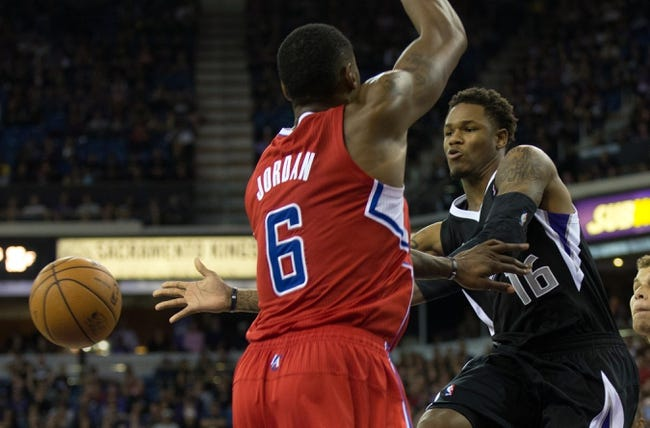 Nov 1, 2013; Sacramento, CA, USA; Sacramento Kings shooting guard Ben McLemore (16) passes the ball around Los Angeles Clippers center DeAndre Jordan (6) during the fourth quarter at Sleep Train Arena. The Los Angeles Clippers defeated the Sacramento Kings 110-101. Mandatory Credit: Kelley L Cox-USA TODAY Sports