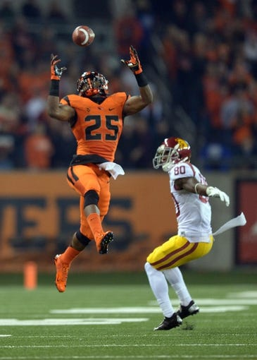 Nov 1, 2013; Corvallis, OR, USA; Oregon State Beavers safety Ryan Murphy (25) intercepts a pass intended for Southern California Trojans receiver De'Von Flournoy (80) and returns it 41-yards for a touchdown in the second quarter at Reser Stadium. USC defeated Oregon State 31-14.  Mandatory Credit: Kirby Lee-USA TODAY Sports