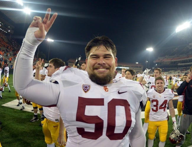 Nov 1, 2013; Corvallis, OR, USA; Southern California Trojans center Abe Markowitz (50) celebrates at the end of the game against the Oregon State Beavers at Reser Stadium. USC defeated Oregon State 31-14.  Mandatory Credit: Kirby Lee-USA TODAY Sports