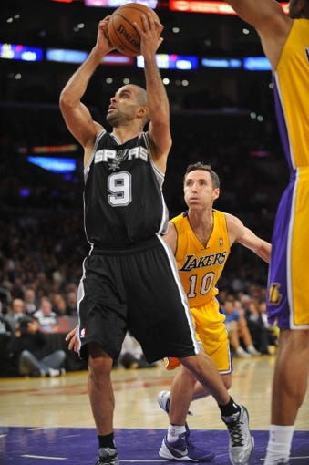 November 1, 2013; Los Angeles, CA, USA; San Antonio Spurs against the Los Angeles Lakers during the second half at Staples Center. Mandatory Credit: Gary A. Vasquez-USA TODAY SportsNovember 1, 2013; Los Angeles, CA, USA; Los Angeles Lakers against the San Antonio Spurs during the second half at Staples Center. Mandatory Credit: Gary A. Vasquez-USA TODAY Sports