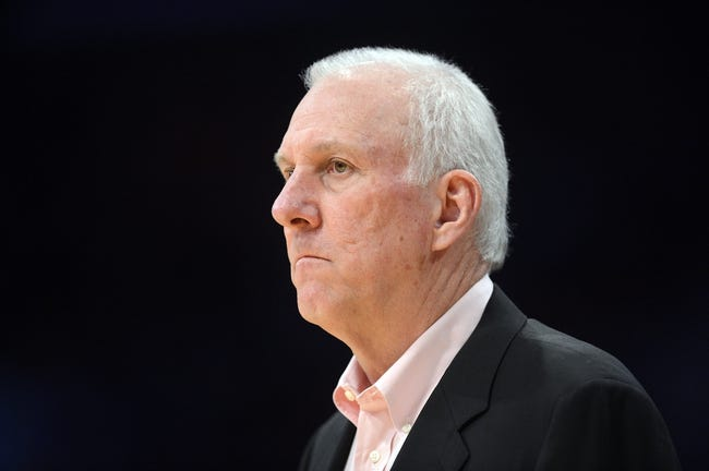 November 1, 2013; Los Angeles, CA, USA; San Antonio Spurs head coach Gregg Popovich watches game action against the Los Angeles Lakers during the second half at Staples Center. Mandatory Credit: Gary A. Vasquez-USA TODAY Sports