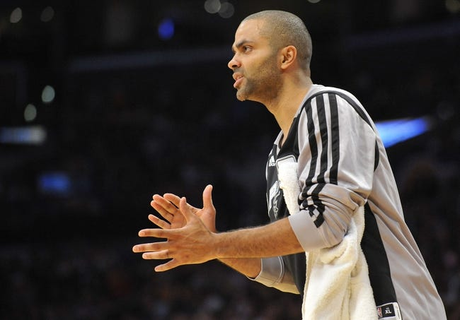 November 1, 2013; Los Angeles, CA, USA; San Antonio Spurs point guard Tony Parker (9) watches game action against the Los Angeles Lakers during the second half at Staples Center. Mandatory Credit: Gary A. Vasquez-USA TODAY Sports