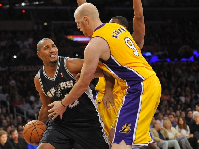 November 1, 2013; Los Angeles, CA, USA; San Antonio Spurs power forward Boris Diaw (33) controls the ball against the defense of Los Angeles Lakers center Chris Kaman (9) during the second half at Staples Center. Mandatory Credit: Gary A. Vasquez-USA TODAY Sports