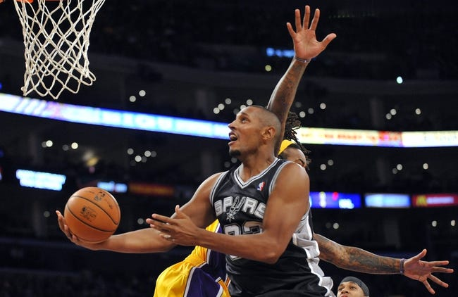 November 1, 2013; Los Angeles, CA, USA; San Antonio Spurs power forward Boris Diaw (33) goes in for a basket against the Los Angeles Lakers during the second half at Staples Center. Mandatory Credit: Gary A. Vasquez-USA TODAY Sports