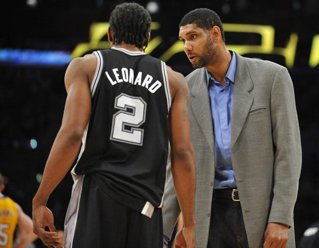 November 1, 2013; Los Angeles, CA, USA; San Antonio Spurs power forward Tim Duncan (21) speaks with small forward Kawhi Leonard (2) during a stoppage in play in the second half at Staples Center. Mandatory Credit: Gary A. Vasquez-USA TODAY Sports