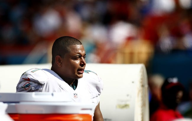 Oct 20, 2013; Miami Gardens, FL, USA; Miami Dolphins tackle Jonathan Martin (71) on the sideline in the second half of a game against the Buffalo Bills at Sun Life Stadium. Mandatory Credit: Robert Mayer-USA TODAY Sports