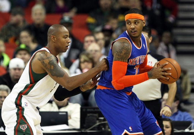 Oct 23, 2013; Green Bay, WI, USA; New York Knicks forward Carmelo Anthony (7) looks to pass as Milwaukee Bucks small forward Caron Butler (3) defends at the Resch Center in Green Bay. The Bucks defeated the Knicks 105-95. Mandatory Credit: Mary Langenfeld-USA TODAY Sports