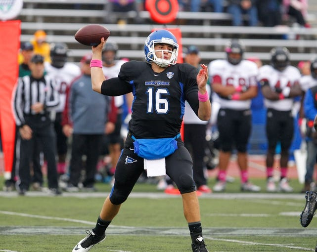 Oct 19, 2013; Buffalo, NY, USA; Buffalo Bulls quarterback Joe Licata (16) throws a pass against the Massachusetts Minutemen at University of Buffalo Stadium. Mandatory Credit: Timothy T. Ludwig-USA TODAY Sports