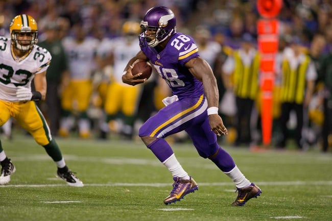 Oct 27, 2013; Minneapolis, MN, USA; Minnesota Vikings running back Adrian Peterson (28) rushes against the Green Bay Packers in the second quarter at Mall of America Field at H.H.H. Metrodome. The Packers win 44-31. Mandatory Credit: Bruce Kluckhohn-USA TODAY Sports