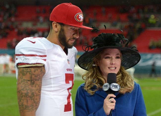 Oct 27, 2013; London, United Kingdom; Fox Sports sideline reporter Jennifer Hale (right) interviews San Francisco 49ers quarterback Colin Kaepernick (7) after the NFL International Series game against the Jacksonville Jaguars at Wembley Stadium. The 49ers defeated the Jaguars 42-10. Mandatory Credit: Kirby Lee-USA TODAY Sports