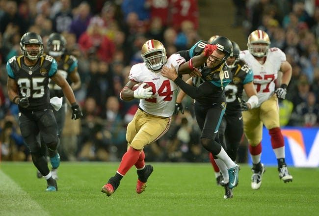 Oct 27, 2013; London, United Kingdom; San Francisco 49ers quarterback Anthony Dixon (24) is tackled by Jacksonville Jaguars kicker Jos Scobee (10) on a 47-yard kickoff return in the NFL International Series game at Wembley Stadium. The 49ers defeated the Jaguars 42-10. Mandatory Credit: Kirby Lee-USA TODAY Sports
