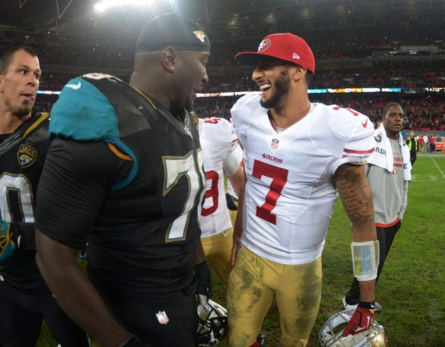 Oct 27, 2013; London, United Kingdom; San Francisco 49ers quarterback Colin Kaepernick (7) and Jacksonville Jaguars offensive lineman Cameron Bradfield (78) visit after  the NFL International Series game at Wembley Stadium. The 49ers defeated the Jaguars 42-10. Mandatory Credit: Kirby Lee-USA TODAY Sports
