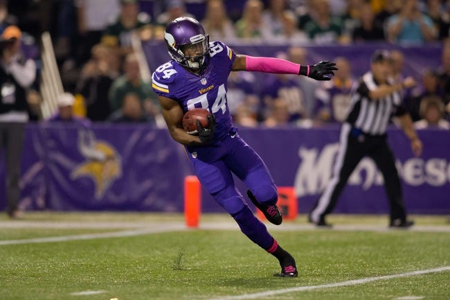 Oct 27, 2013; Minneapolis, MN, USA; Minnesota Vikings wide receiver Cordarrelle Patterson (84) returns a kickoff against the Green Bay Packers in the first quarter at Mall of America Field at H.H.H. Metrodome. The Packers win 44-31. Mandatory Credit: Bruce Kluckhohn-USA TODAY Sports