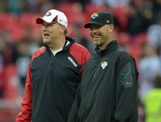 Oct 27, 2013; London, United Kingdom; San Francisco 49ers special teams coach Brad Seely (left) and Jacksonville Jaguars coach Gus Bradley before the NFL International Series game at Wembley Stadium. Mandatory Credit: Kirby Lee-USA TODAY Sports