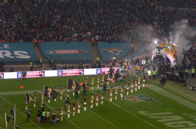 Oct 27, 2013; London, United Kingdom; General view of Jacksonville Jaguars mascot Jaxson De Ville with British and United States flags and players entering the field before the NFL International Series game against the San Francisco 49ers at Wembley Stadium. The 49ers defeated the Jaguars 42-10. Mandatory Credit: Kirby Lee-USA TODAY Sports