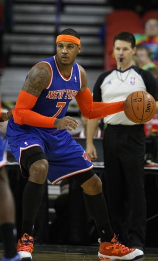 Oct 23, 2013; Green Bay, WI, USA; New York Knicks forward Carmelo Anthony (7) looks to pass as his team plays the Milwaukee Bucks at the Resch Center in Green Bay. The Bucks defeated the Knicks 105-95. Mandatory Credit: Mary Langenfeld-USA TODAY Sports