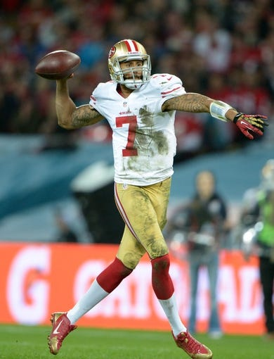 Oct 27, 2013; London, United Kingdom; San Francisco 49ers quarterback Colin Kaepernick (7) throws a pass in the NFL International Series game against the Jacksonville Jaguars at Wembley Stadium. The 49ers defeated the Jaguars 42-10. Mandatory Credit: Kirby Lee-USA TODAY Sports