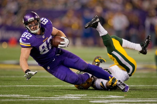 Oct 27, 2013; Minneapolis, MN, USA; Minnesota Vikings tight end Kyle Rudolph (82) catches a pass and Green Bay Packers safety Morgan Burnett (42) tackles him in the second quarter at Mall of America Field at H.H.H. Metrodome. The Packers win 44-31. Mandatory Credit: Bruce Kluckhohn-USA TODAY Sports