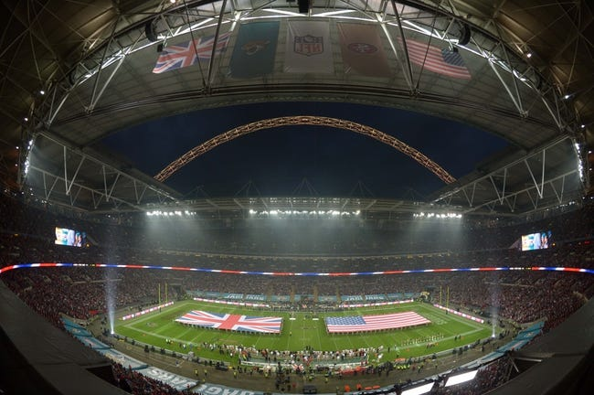 Oct 27, 2013; London, United Kingdom; General view of British and United States flags on the field during the playing of the national anthem before the NFL International Series game between the San Francisco 49ers and the Jacksonville Jaguars at Wembley Stadium. Mandatory Credit: Kirby Lee-USA TODAY Sports