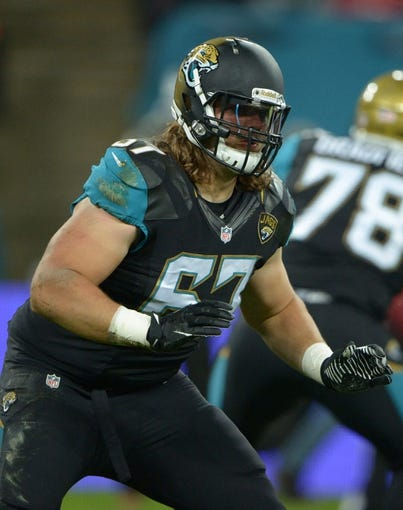 Oct 27, 2013; London, United Kingdom; Jacksonville Jaguars guard Austin Pasztor (67) during the NFL International Series game against the San Francsico 49ers at Wembley Stadium. The 49ers defeated the Jaguars 42-10. Mandatory Credit: Kirby Lee-USA TODAY Sports