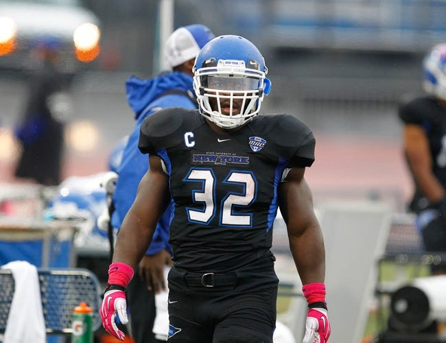 Oct 19, 2013; Buffalo, NY, USA; Buffalo Bulls running back Branden Oliver (32) against the Massachusetts Minutemen at University of Buffalo Stadium. Mandatory Credit: Timothy T. Ludwig-USA TODAY Sports