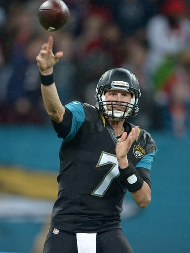 Oct 27, 2013; London, United Kingdom; Jacksonville Jaguars quarterback Chad Henne (7) throws a pass against the San Francisco 49ers in the NFL International Series game at Wembley Stadium. The 49ers defeated the Jaguars 42-10. Mandatory Credit: Kirby Lee-USA TODAY Sports