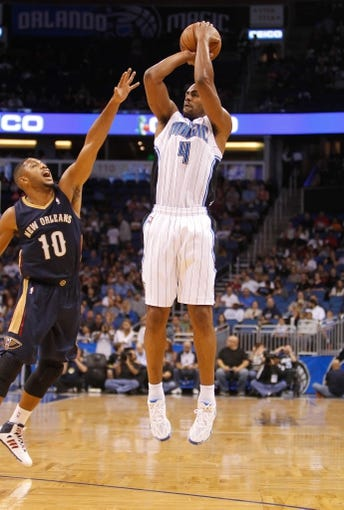 Oct 25, 2013; Orlando, FL, USA; Orlando Magic shooting guard Arron Afflalo (4) shoots as New Orleans Pelicans shooting guard Eric Gordon (10) defends during the first quarter at Amway Center. Mandatory Credit: Kim Klement-USA TODAY Sports