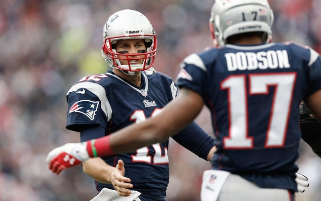 Oct 27, 2013; Foxborough, MA, USA; New England Patriots quarterback Tom Brady (12) talks with New England Patriots wide receiver Aaron Dobson (17) during the third quarter against the Miami Dolphins at Gillette Stadium. Mandatory Credit: Winslow Townson-USA TODAY Sports