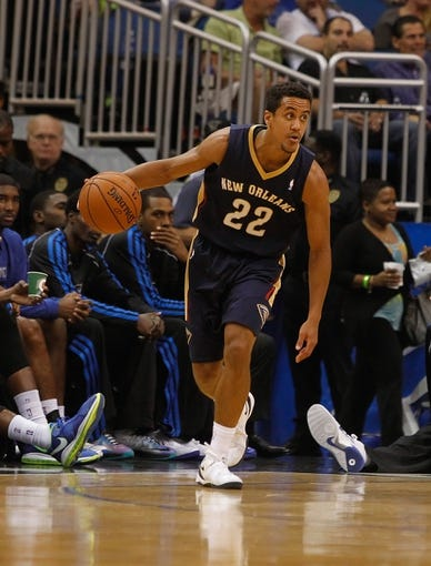 Oct 25, 2013; Orlando, FL, USA; New Orleans Pelicans point guard Brian Roberts (22) dribbles the ball against the Orlando Magic during the first half at Amway Center. Mandatory Credit: Kim Klement-USA TODAY Sports