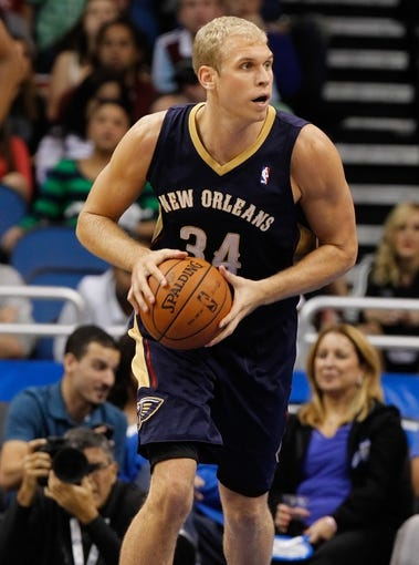Oct 25, 2013; Orlando, FL, USA; New Orleans Pelicans center Greg Stiemsma (34) against the Orlando Magic during the second half at Amway Center. New Orleans Pelicans defeated the Orlando Magic 101-82.  Mandatory Credit: Kim Klement-USA TODAY Sports