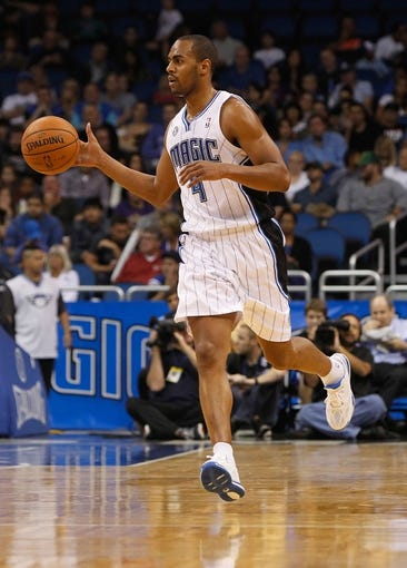 Oct 25, 2013; Orlando, FL, USA; Orlando Magic shooting guard Arron Afflalo (4) dribbles the ball against the New Orleans Pelicans during the first quarter at Amway Center. Mandatory Credit: Kim Klement-USA TODAY Sports