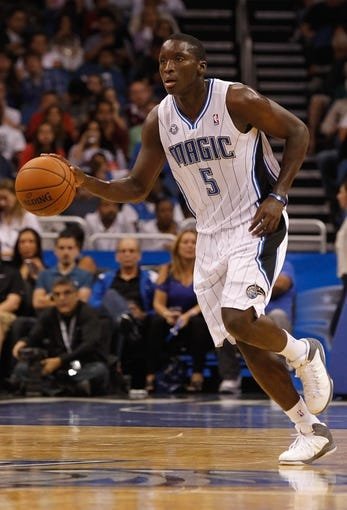 Oct 25, 2013; Orlando, FL, USA; Orlando Magic shooting guard Victor Oladipo (5) dribbles the ball against the New Orleans Pelicans during the first quarter at Amway Center. Mandatory Credit: Kim Klement-USA TODAY Sports