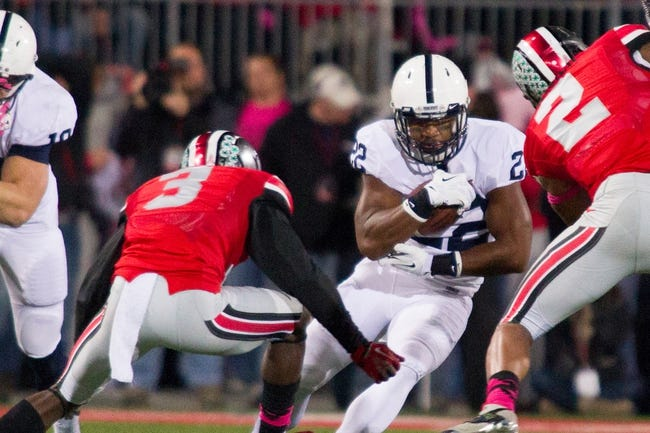 Oct 26, 2013; Columbus, OH, USA;  Penn State Nittany Lions running back Akeel Lynch (22) runs the ball against Ohio State Buckeyes defensive back Corey Brown (3) in the game at Ohio Stadium. The Ohio State Buckeyes beat the Penn State Nittany Lions 63-14. Mandatory Credit: Trevor Ruszkowksi-USA TODAY Sports