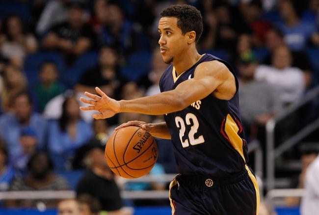 Oct 25, 2013; Orlando, FL, USA; New Orleans Pelicans point guard Brian Roberts (22) against the Orlando Magic during the second half at Amway Center. New Orleans Pelicans defeated the Orlando Magic 101-82.  Mandatory Credit: Kim Klement-USA TODAY Sports