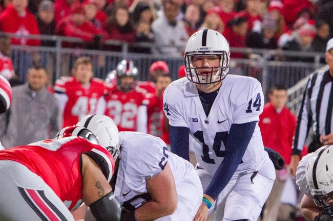 Oct 26, 2013; Columbus, OH, USA;  Penn State Nittany Lions quarterback Christian Hackenberg (14) under center in the game against the Ohio State Buckeyes at Ohio Stadium. The Ohio State Buckeyes beat the Penn State Nittany Lions 63-14. Mandatory Credit: Trevor Ruszkowksi-USA TODAY Sports