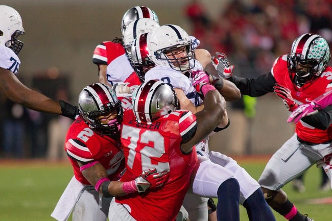 Oct 26, 2013; Columbus, OH, USA; Penn State Nittany Lions running back Zach Zwinak (28) is tackled by Ohio State Buckeyes linebacker Ryan Shazier (2) and  defensive lineman Chris Carter (72) at Ohio Stadium. The Ohio State Buckeyes beat the Penn State Nittany Lions 63-14. Mandatory Credit: Trevor Ruszkowksi-USA TODAY Sports