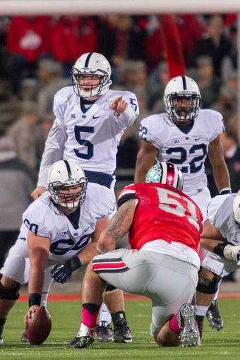 Oct 26, 2013; Columbus, OH, USA;  Penn State Nittany Lions quarterback Tyler Ferguson (5) calling out protections to center Ty Howle (60) and running back Akeel Lynch (22)  in the game against the Ohio State Buckeyes at Ohio Stadium. The Ohio State Buckeyes beat the Penn State Nittany Lions 63-14. Mandatory Credit: Trevor Ruszkowksi-USA TODAY Sports