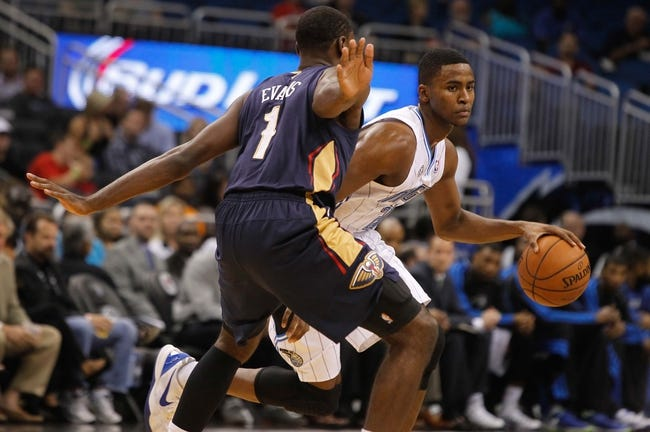Oct 25, 2013; Orlando, FL, USA; Orlando Magic small forward Maurice Harkless (21) dribbles the ball as New Orleans Pelicans point guard Tyreke Evans (1) defends during the first quarter at Amway Center. Mandatory Credit: Kim Klement-USA TODAY Sports