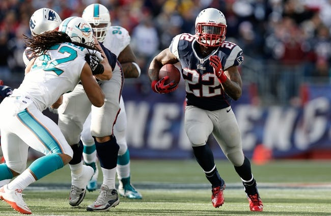Oct 27, 2013; Foxborough, MA, USA; New England Patriots running back Stevan Ridley (22) runs against the Miami Dolphins during the fourth quarter of their 27-17 win at Gillette Stadium. Mandatory Credit: Winslow Townson-USA TODAY Sports