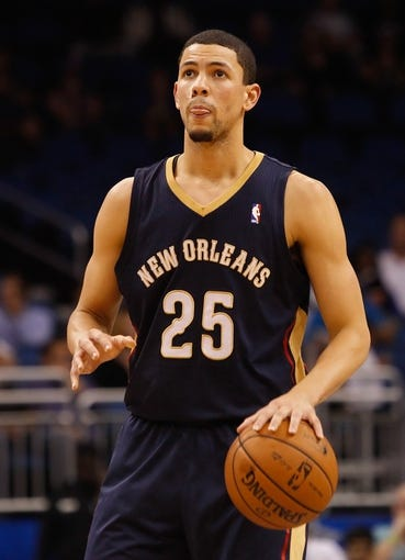 Oct 25, 2013; Orlando, FL, USA; New Orleans Pelicans shooting guard Austin Rivers (25) against the Orlando Magic during the second half at Amway Center. New Orleans Pelicans defeated the Orlando Magic 101-82.  Mandatory Credit: Kim Klement-USA TODAY Sports