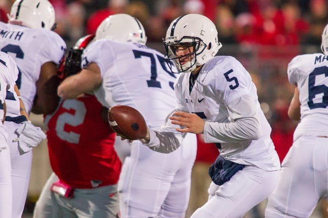 Oct 26, 2013; Columbus, OH, USA; Penn State Nittany Lions quarterback Tyler Ferguson (5) hands the ball off in the game against the Ohio State Buckeyes at Ohio Stadium. The Ohio State Buckeyes beat the Penn State Nittany Lions 63-14. Mandatory Credit: Trevor Ruszkowksi-USA TODAY Sports