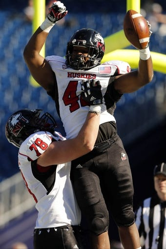 Nov 2, 2013; Foxborough, MA, USA; Northern Illinois Huskies running back Cameron Stingily (42) is congratulated by offensive linesman Ryan Brown (78) after scoring against the Massachusetts Minutemen during the second quarter at Gillette Stadium. Mandatory Credit: David Butler II-USA TODAY Sports